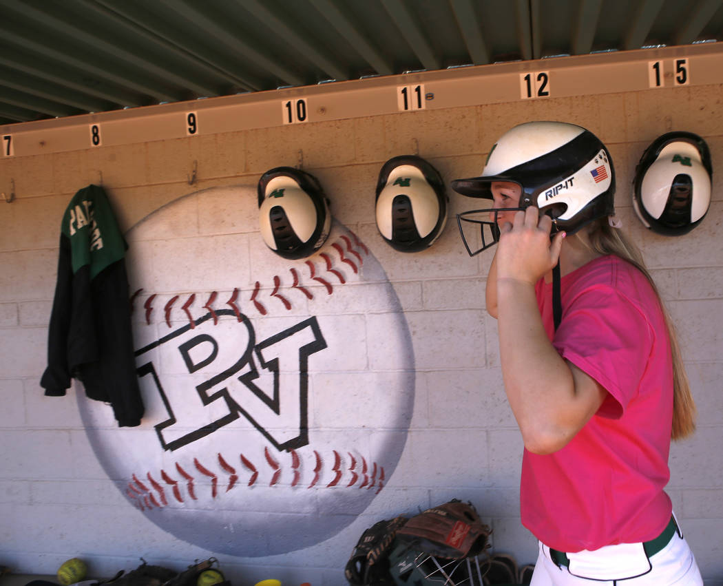 Ally Snelling (12) puts on her helmet to bat during a high school softball game at Palo Verde High School on Friday, April 21, 2017, in Las Vegas. Snelling was recently accepted into West Point. C ...