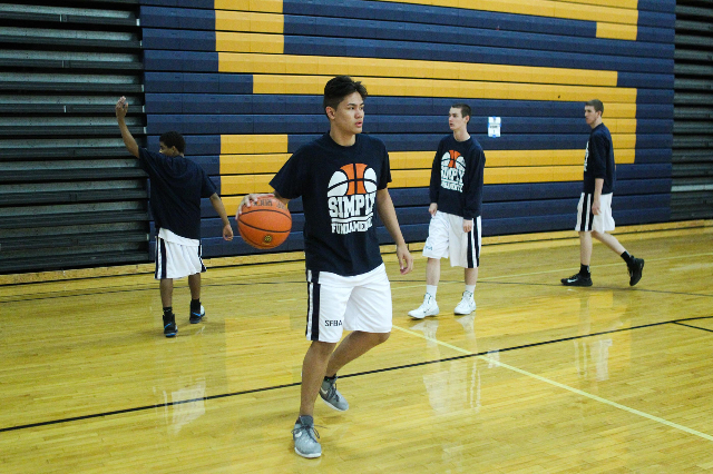 Maka Ellis (32) warms up with his team Simply Fundamental during the Las Vegas Fab 48 at Sierra Vista High School on Thursday, July 23 2015. Ellis is a sophomore at Sierra Vista High School. (Jame ...