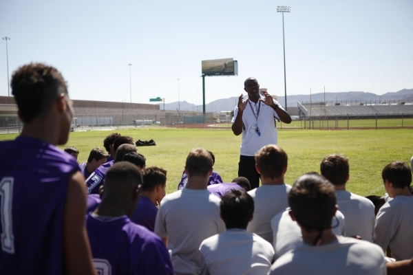 "Randall Cunningham speaks to his players during practice Monday at Silverado High School. ""Right now, we're in the learning stages,"" he said after the noncontact practice.   ERIK V ..."