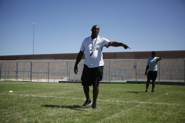 Randall Cunningham, Silverado High School head football coach, gives directions during practice at Silverado High School in Las Vegas on Monday, August 10, 2015. Cunningham is a pastor and former  ...