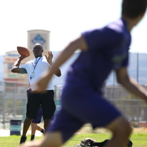 Silverado High School football coach Randall Cunningham throws during practice Monday.   ERIK VERDUZCO/LAS VEGAS REVIEW-JOURNAL Follow him