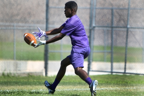 "Silverado's Vernon Jackson reaches for the ball during practice Monday. Jackson says of the school's new head coach, Randall Cunningham: ""He'll try to make sure to perfect w ..."