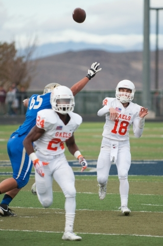 Bishop Gorman's Tate Martell (18) throws a pass down field against the Raiders during the first half of the NIAA Nevada State High School Division I Championships game at Damonte Ranch High  ...