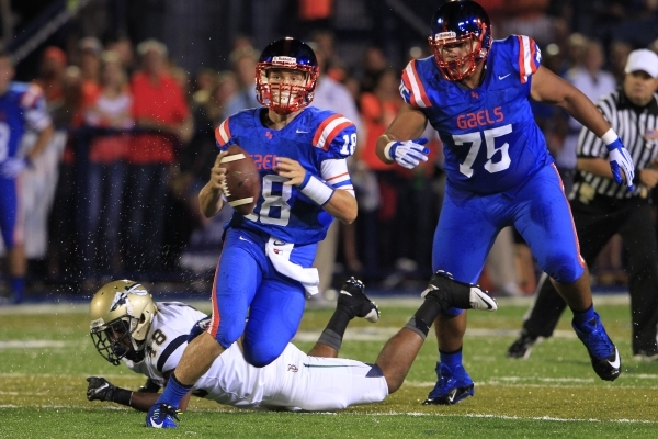 Bishop Gorman quarterback Tate Martell scrambles past St. John Bosco defensive back Bryce Turner during their game Friday, Sept. 26, 2014 at Bishop Gorman. (Sam Morris/Las Vegas Review-Journal)
