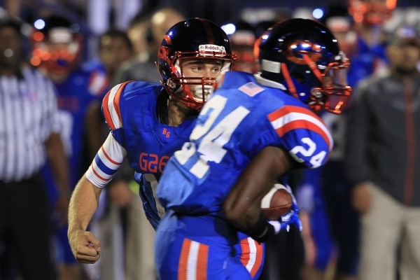 Bishop Gorman quarterback Tate Martell hands off to halfback Russell Booze during their game against St. John Bosco Friday, Sept. 26, 2014 at Bishop Gorman. Gorman won the game 34-31. (Sam Morris/ ...