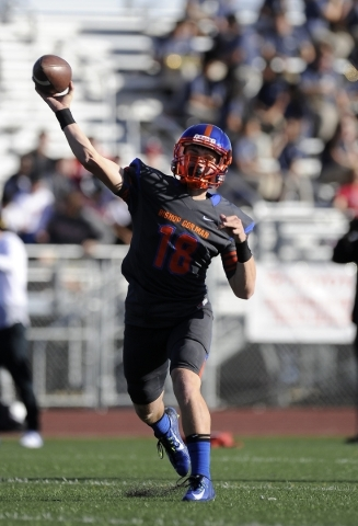 Bishop Gorman quarterback Tate Martell passes in the first half of a Division I state semifinal against Liberty at Rancho High School in November. Martell threw for 2,537 yards and 40 touchdowns a ...