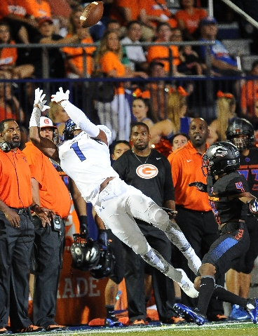 Chandler wide receiver N'keal Harry (1) catches a pass as Bishop Gorman defensive back Alex Perry (4) defends in the second quarter of their high school football game at Bishop Gorman High S ...