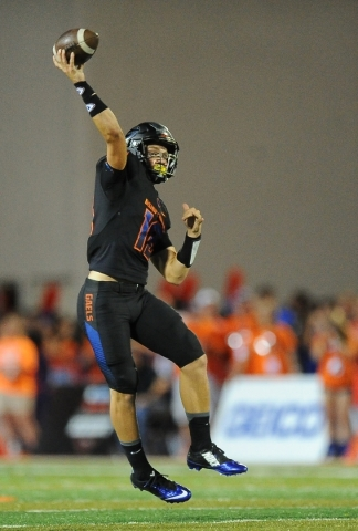 Bishop Gorman quarterback Tate Martell throws a touchdown pass against Chandler (Ariz.) in the second quarter of their nationally televised prep football game at Bishop Gorman on Saturday. JOSH HO ...