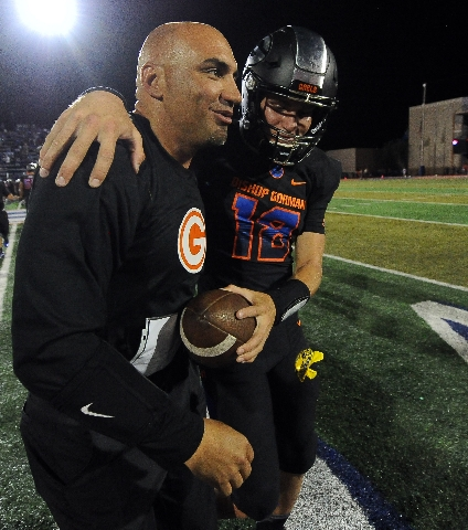 Bishop Gorman head coach Kenny Sanchez and starting quarterback Tate Martell embrace after their 35-14 victory over Chandler, Ariz., during their high school football game at Bishop Gorman High Sc ...