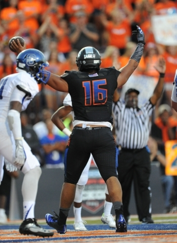 Bishop Gorman linebacker Haskell Garrett celebrates his touchdown against Chandler, AZ in the second quarter of their high school football game at Bishop Gorman High School in Las Vegas Saturday,  ...