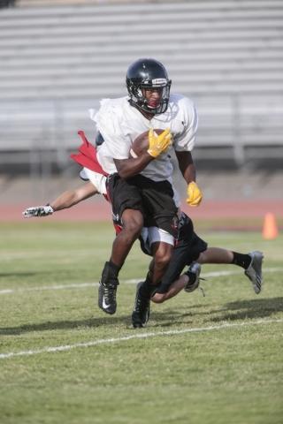 Las Vegas High School running back Elijah Hicks runs a drill during football practice at the school Wednesday, Sept. 2, 2015. Donavon Lockett/Las Vegas Review-Journal