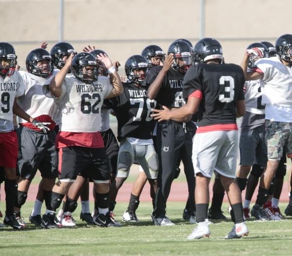 Las Vegas High School linebacker Cruz Littlefield leads warmups before football practice at the school Wednesday, Sept. 2, 2015. Donavon Lockett/Las Vegas Review-Journal