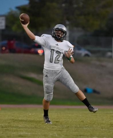 Green Valley quarterback A.J. Amelburu passes the ball against Las Vegas during a high school football game at Las Vegas High School on Friday, Sept. 4, 2015. (David Becker/Las Vegas Review-Journal)