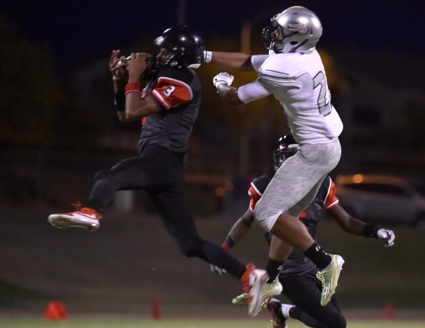 Las Vegas' Zachary Loveland (3) snags an interception from Green Valley's Brayon Williams during the first half of a high school football game at Las Vegas High School on Friday, Sept. ...