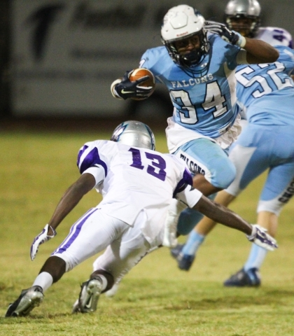 Foothill's Justice Jackson (34) jumps to evade Silverado's Vernon Jackson (13) during a football game at Foothill High School in Henderson on Friday, Sept. 4, 2015. Chase Stevens/Las V ...