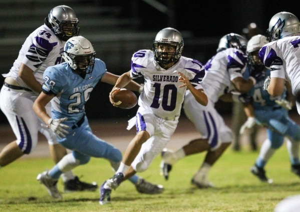 Silverado's Micah Weber (10) runs the ball against Foothill during a football game at Foothill High School in Henderson on Friday, Sept. 4, 2015. Chase Stevens/Las Vegas Review-Journal Follo ...
