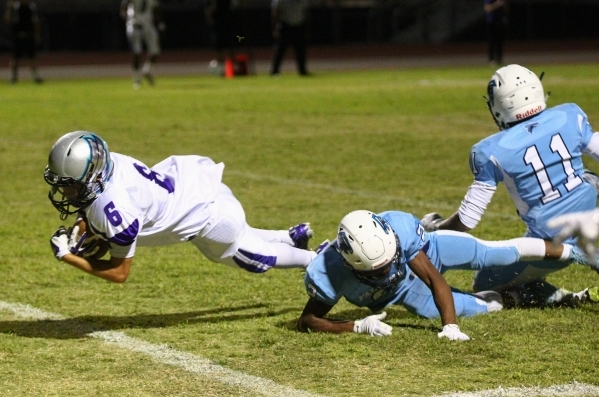 Silverado's Evan Tafoya (6) gets past Foothill defense to score a touchdown during a football game at Foothill High School in Henderson on Friday, Sept. 4, 2015. Chase Stevens/Las Vegas Revi ...