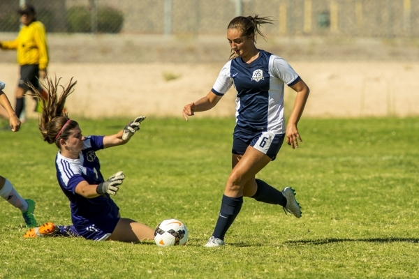 Katherine Ballou (6) of the Foothill Falcons takes the ball past Mikaila Becze of the Silverado Skyhawks during a soccer match at Silverado High School in Las Vegas on Tuesday, Sept. 8, 2015. (Jos ...