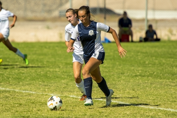 Katherine Ballou (6) of the Foothill Falcons takes the ball past Kayla McGinnis of the Silverado Skyhawks during a soccer match at Silverado High School in Las Vegas on Tuesday, Sept. 8, 2015. (Jo ...