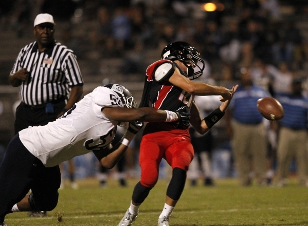 Centennial defensive lineman Greg Rogers tackles Las Vegas quarterback Trevor Swenson at Las Vegas high School in Las Vegas on Saturday, Sept. 27, 2014. (Justin Yurkanin/Las Vegas Review-Journal)
