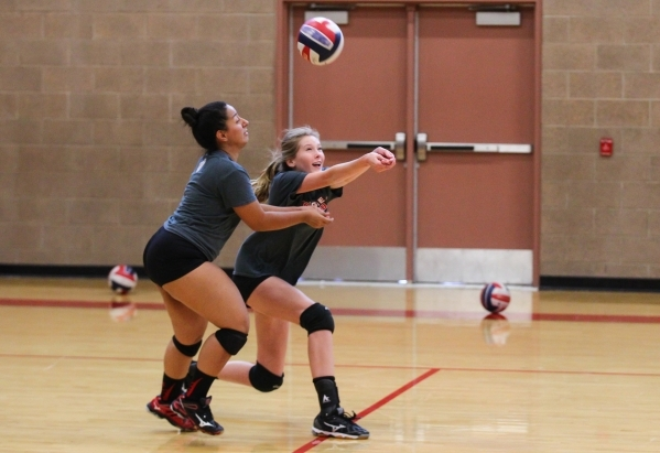 Arbor View middle blocker Alexis Kershaw, right, and libero Alyssa Jeeves look to return ball during volleyball practice in Las Vegas on Tuesday, Sept. 15, 2015. Chase Stevens/Las Vegas Review-Jou ...