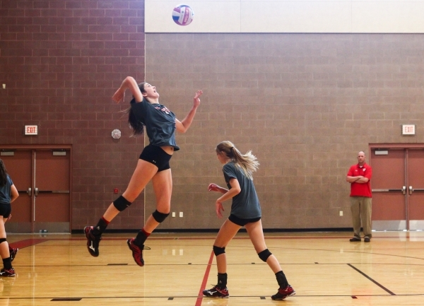 Arbor View outside hitter Hannah Goddard, left, jumps to serve the ball during volleyball practice in Las Vegas on Tuesday, Sept. 15, 2015. Chase Stevens/Las Vegas Review-Journal Follow @csstevens ...