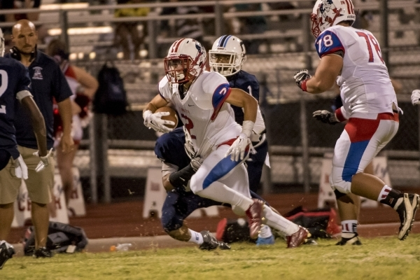 Liberty Patriots wide receiver Ethan Dedeaux (2) runs with the ball against the Centennial Bulldogs at Carol Leavitt Stadium at Centennial High School in Las Vegas on Friday, Sept. 18, 2015. Joshu ...