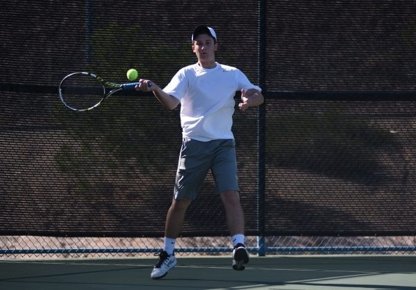 Brandon Sulzberg, 16, of Palo Verde High School hits the ball during the Sunset region tournament doubles championship from the Darling Tennis Center in Las Vegas on Tuesday, Oct. 20, 2015. Sultzb ...