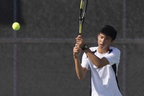 Michael Pasimio of Ed W. Clark High School plays against South Tahoe High School during the Division I-A Sunset boys tennis semifinals at Darling Tennis Center in Las Vegas Thursday, Oct. 22, 2015 ...
