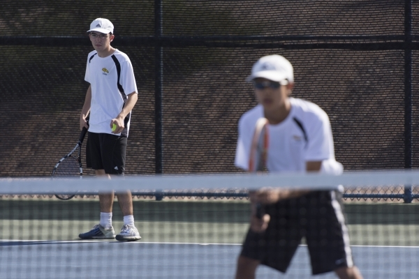 Derek Stratton, left, and Justin Ong of Ed W. Clark High School play against South Tahoe High School during the Division I-A Sunset boys tennis semifinals at Darling Tennis Center in Las Vegas Thu ...