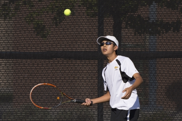 Justin Ong of Ed W. Clark High School plays against South Tahoe High School during the Division I-A Sunset boys tennis semifinals at Darling Tennis Center in Las Vegas Thursday, Oct. 22, 2015. Jas ...
