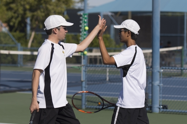 Derek Stratton, left, and Justin Ong of Ed W. Clark High School high five while playing against South Tahoe High School during the Division I-A Sunset boys tennis semifinals at Darling Tennis Cent ...