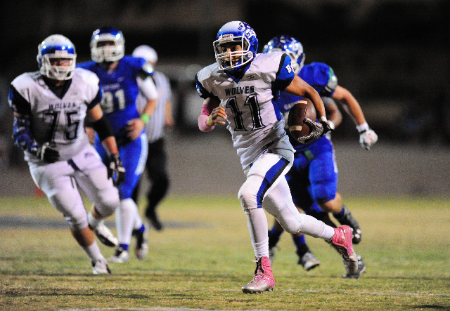 Basic Wolves quarterback Aeneas McAllister (11) scores a touchdown against Green Valley in the first quarter of their prep football game at Green Valley High School in Henderson Friday, Oct. 9, 20 ...