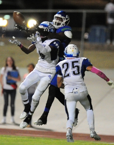 Basic Wolves cornerback Deondre Ishman (6) breaks up a pass intended for Green Valley Gators wide receiver Marquez Powell on the second to last play of the game during their prep football game at  ...