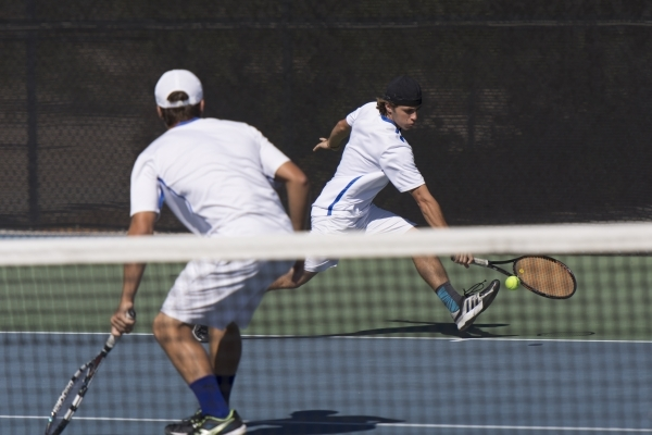 Skylar Davidson, right, and Sam Sholeff of Bishop Gorman High School plays against Coronado High School during the Division I boys doubles tennis championship at Darling Tennis Center in Las Vegas ...