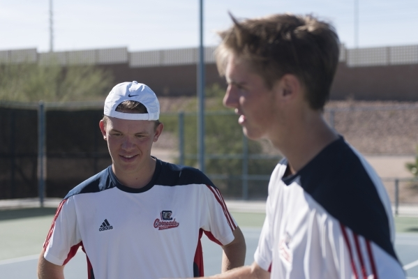 Sam Grant, left, and Ryland McDermott of Coronado High School celebrate after winning against Bishop Gorman High School during the Division I boys doubles tennis championship at Darling Tennis Cen ...