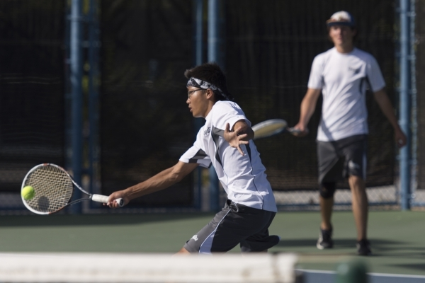 Andy Beckstrand, left, and Koby Frei of Moapa Valley High School play against Ed W. Clark High School during the Division I-A boys doubles tennis championship at Darling Tennis Center in Las Vegas ...