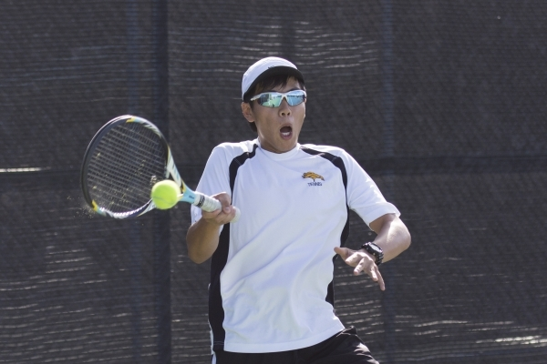 Christian Ong of Ed W. Clark High School plays against Moapa Valley High School during the Division I-A boys doubles tennis championship at Darling Tennis Center in Las Vegas Saturday, Oct. 24, 20 ...