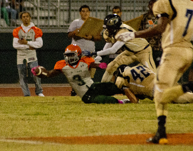 Mojave's Elijah Smoot (3) extends the ball for more yardage at the end of a run during their prep football game at Mojave High School on Friday, Oct. 9, 2015. Daniel Clark/Las Vegas Review-J ...