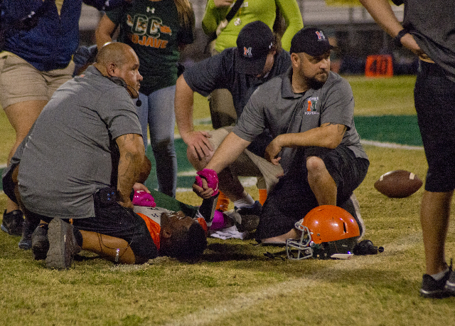Mojave running back Elijah Smoot (3) lies injured on the field during their prep football game at Mojave High School on Friday, Oct. 9, 2015. Daniel Clark/Las Vegas Review-Journal