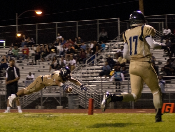 Mojave's George Carmona (42) dives for a touchdown during their prep football game at Mojave High School on Friday, Oct. 9, 2015. Daniel Clark/Las Vegas Review-Journal