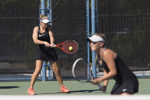 Chloe Henderson, left, and Sophie Henderson of Palo Verde High School play against Liberty High School during the Division I girls doubles tennis championship at Darling Tennis Center in Las Vegas ...