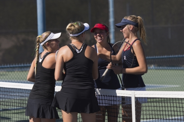 Sophie Henderson, from left, and Chloe Henderson of Palo Verde High School shake hands with Payton Burk and Parker Burk of Liberty High School during the Division I girls doubles tennis championsh ...