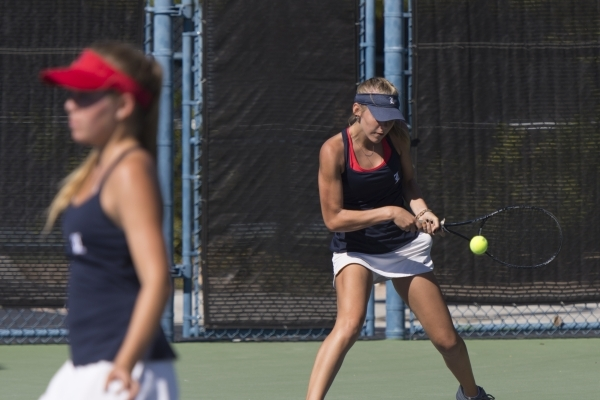 Parker Burk, right, and Payton Burk of Liberty High School play against Palo Verde High School during the Division I girls doubles tennis championship at Darling Tennis Center in Las Vegas Saturda ...