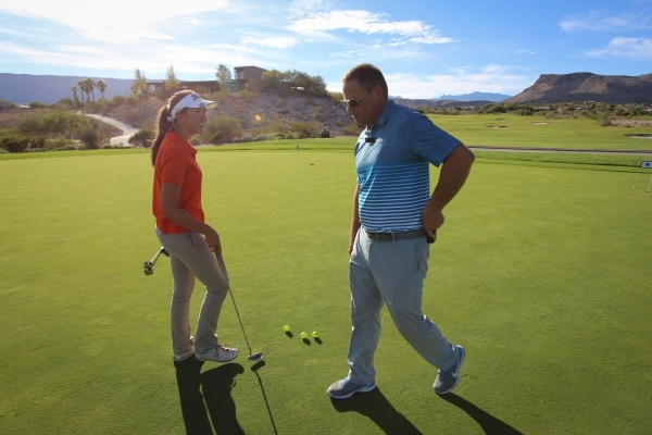 Bishop Gorman sophomore Hunter Pate, left, talks with head coach Jim Stanfill, right, during a practice at Bear's Best Las Vegas on Thursday, Oct. 8, 2015 in Las Vegas. (Brett LeBlanc / Las  ...