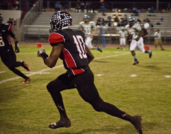 Las Vegas' Elijah Hicks (10) sprints up the sideline during their prep football game against Canyon Springs High School at Las Vegas High School on Friday, Oct. 16, 2015. Las Vegas won, 34-2 ...