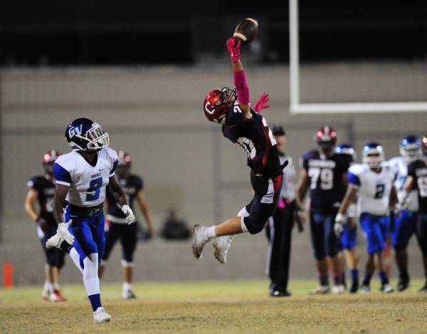 Coronado Cougars wide receiver Justin Serafino (20) is unable to make a catch as Green Valley Gators cornerback Nahzi Salih looks on in the first half of their prep football game at Coronado High  ...