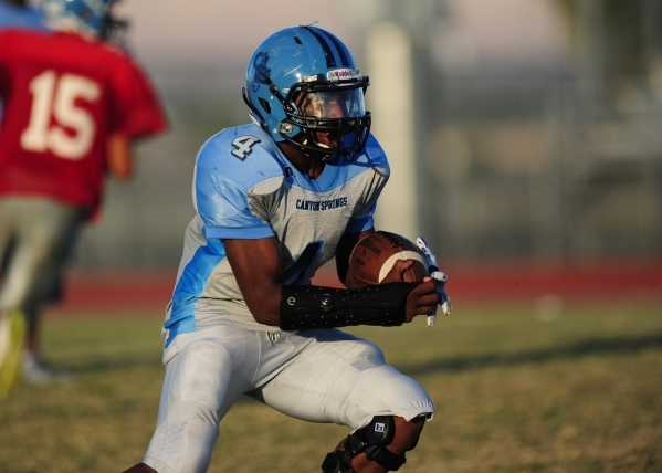 Canyon Springs running back Marcell Selmon rushes the ball during football practice at Canyon Springs High School in North Las Vegas Wednesday, Oct. 14, 2015. Josh Holmberg/Las Vegas Review-Journal