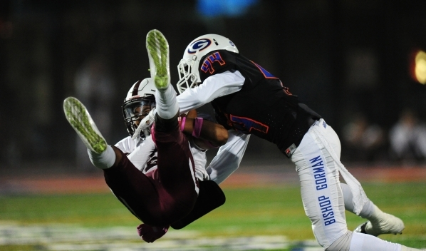Bishop Gorman defensive back/wide receiver Brendan Radley-Hiles (44) smashes into Don Bosco wide receiver Elijah Singh in the first half of their prep football game at Bishop Gorman High School in ...