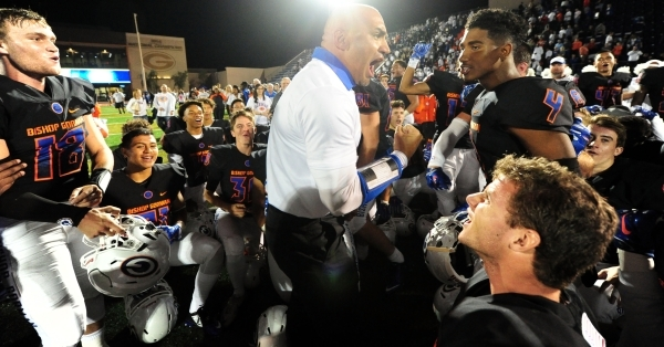Bishop Gorman head coach Kenny Sanchez and players celebrate their 30-16 win over Don Bosco after their prep football game at Bishop Gorman High School in Las Vegas Friday Oct. 23, 2015. Josh Holm ...